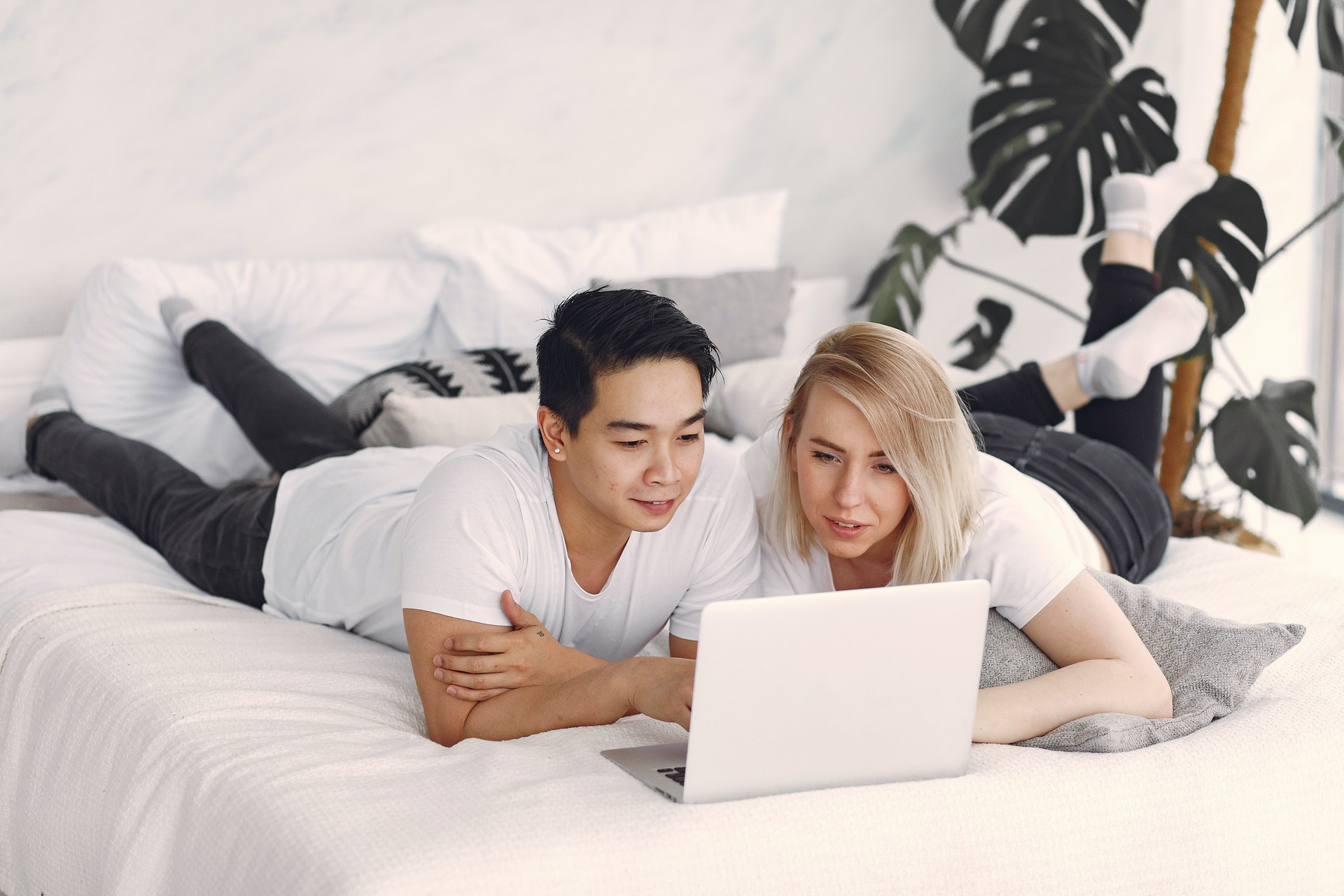 Couple working on their budget so that they can become debt-free